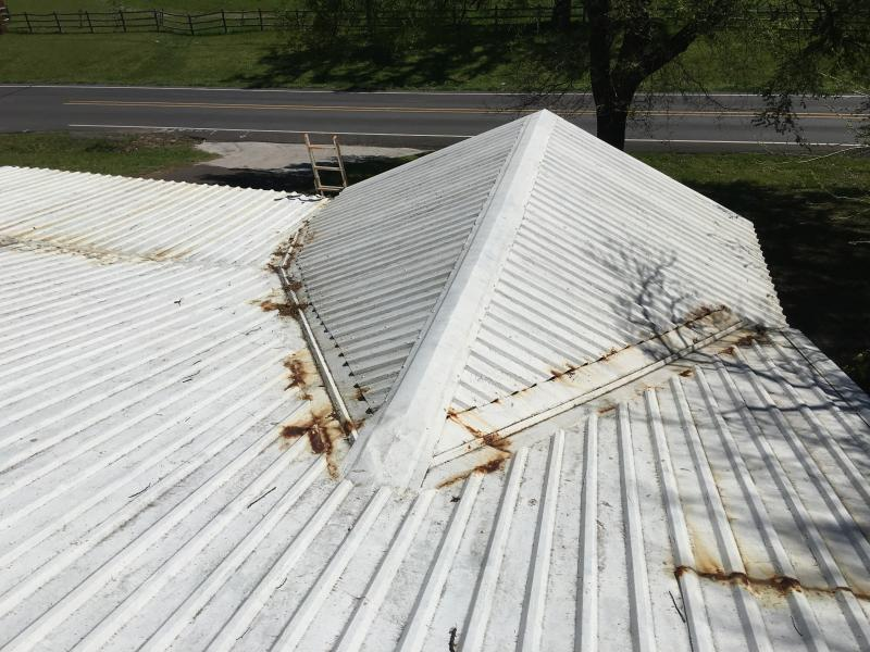 Metal roof neglect. Paint traps water and rusts underneath.